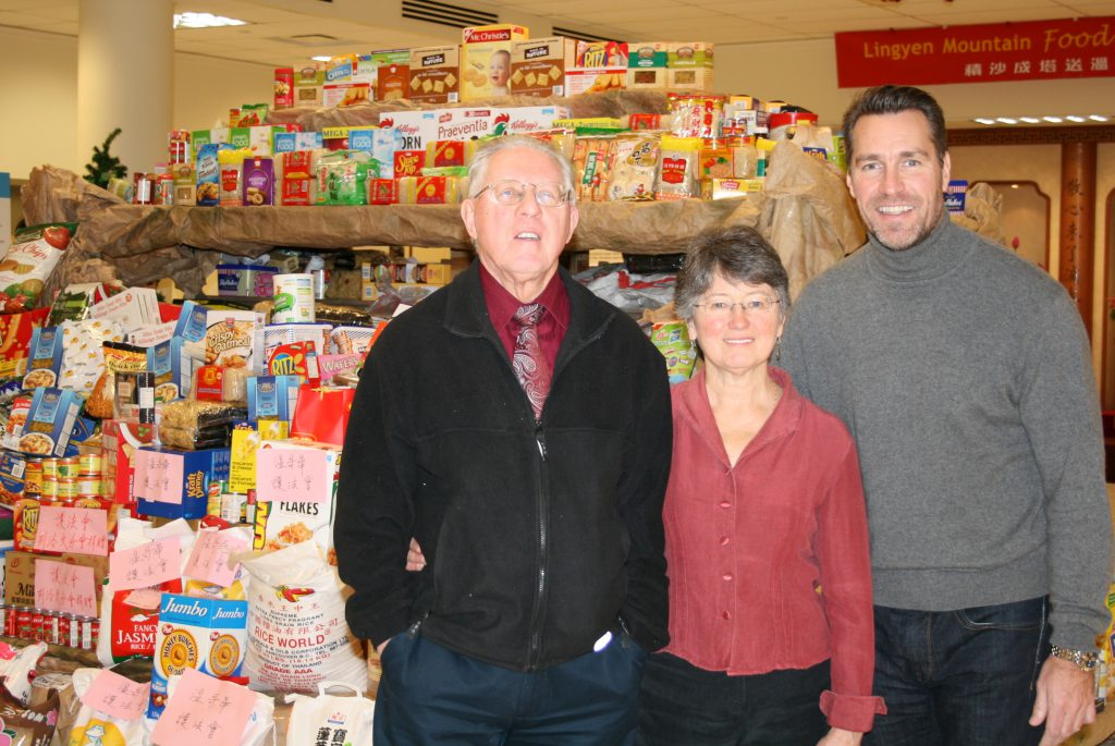Chris Morris and Margaret Hewlett of the Richmond Food Bank with Kirk McLean, retired Vancouver Canuck
