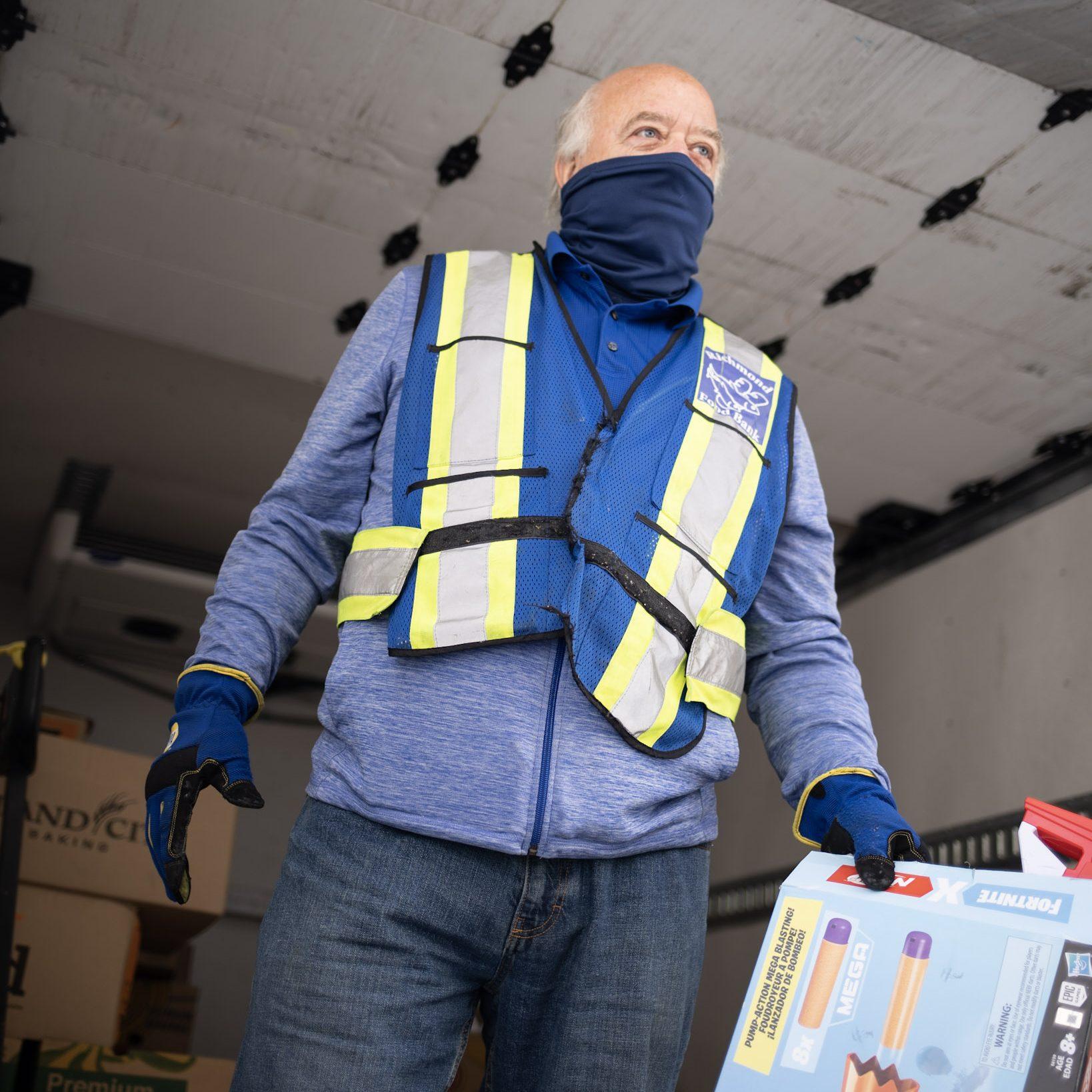 food bank volunteer driver unloads donations from truck